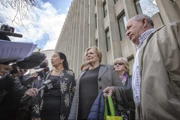 The parents of Dr. Elana Fric, followed by friends and family of the murdered family doctor, leave Superior Court of Justice in Toronto on Apr. 8, 2019.