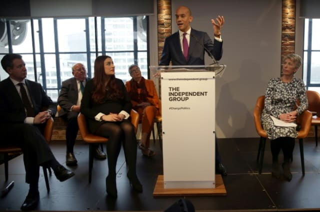 (L-R) Labour party MPs Chris Leslie, Mike Gapes, Luciana Berger, Ann Coffey, Angela Smith and Gavin Shuker listen as Chuka Umunna at a press conference in London on February 18, 2019 where they announced they were resigning from the party