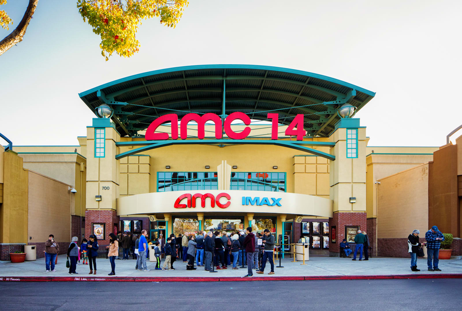 AMC multiplex movie theater entrance facade with sign