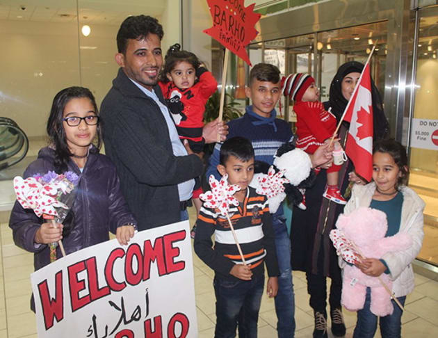 Members of the Barho family are shown upon arrival at the Halifax airport in a handout photo on Sept....