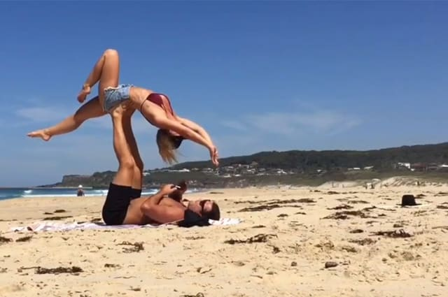 Aussie man makes surprise proposal to his girlfriend during beach 'acro-yoga'
