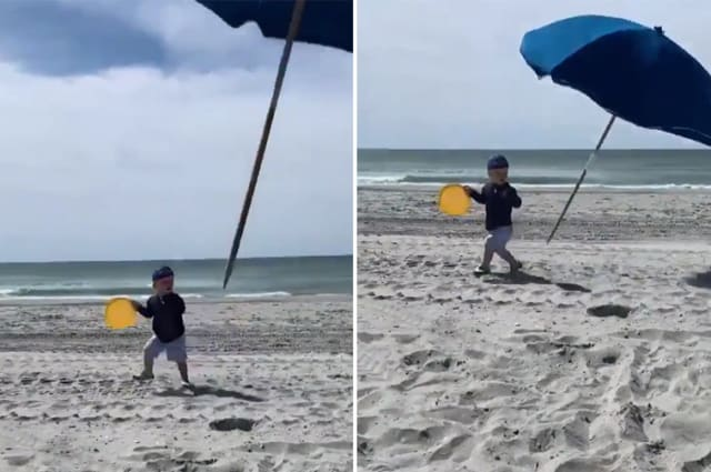 Toddler nearly impaled by flying beach umbrella