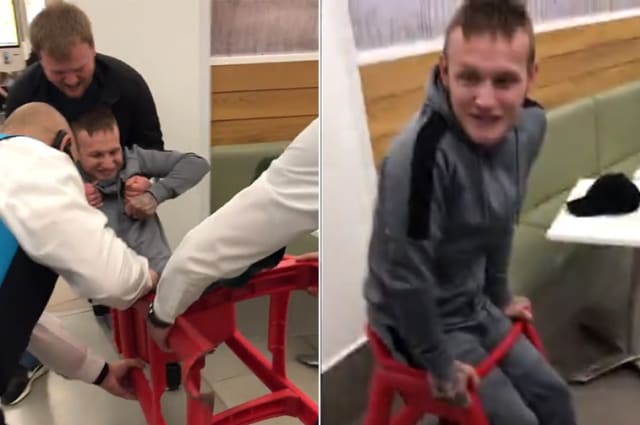 Hilarious moment man is rescued from child's high chair