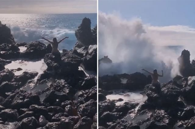 Take my picture! Woman knocked over by a large wave in Hawaii