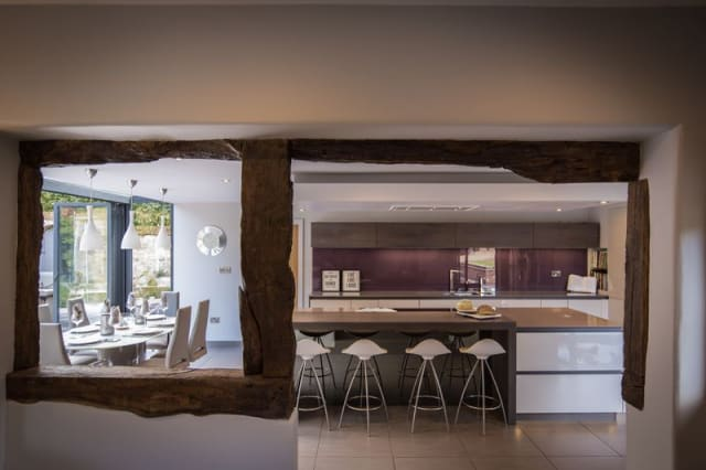 View of the kitchen through a beamed opening