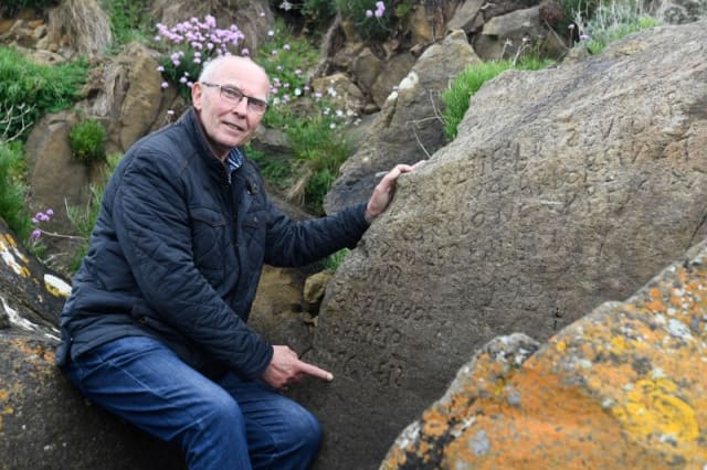 French village offers reward to anyone who can decode 'mystery' rock inscription