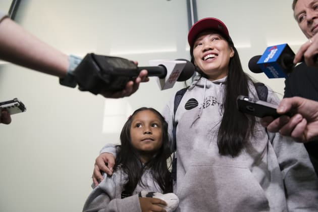 Vanessa Rodel and her seven-year-old daughter Keana at Lester B. Pearson Airport in Toronto, on March...