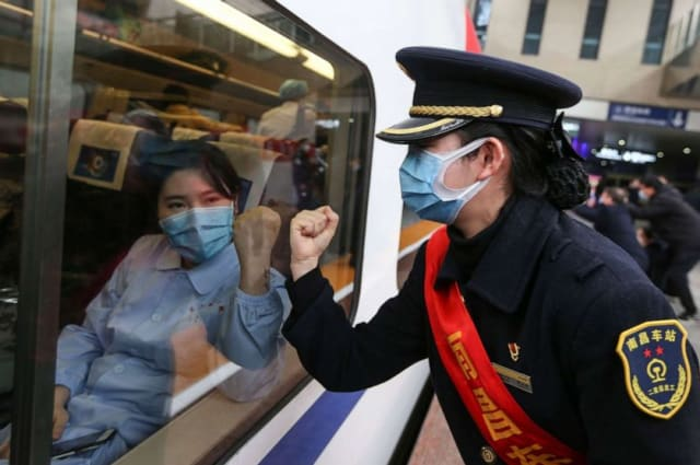 China says 1,716 health workers among over 63,000 infected by novel coronavirus