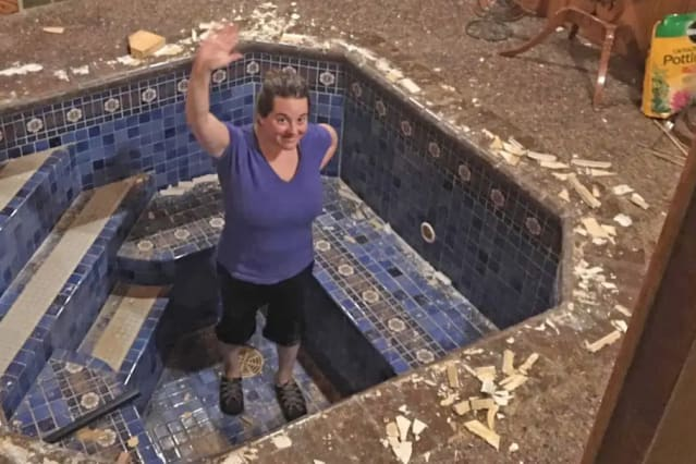Couple uncover stunning bath under the floor of their home office