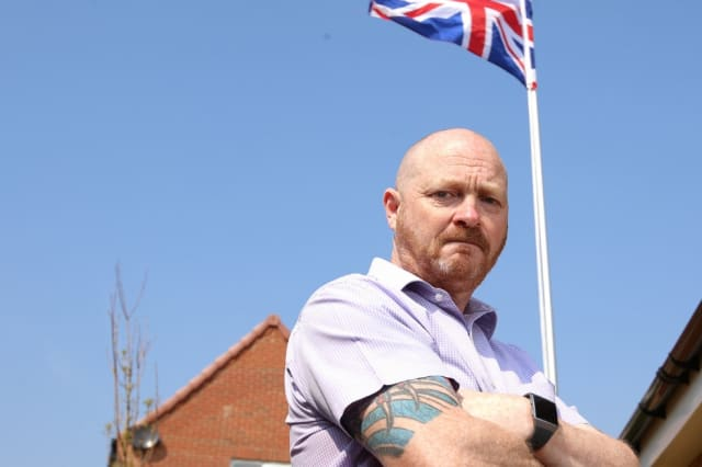 Man with Union Jack flag been forced to remove it