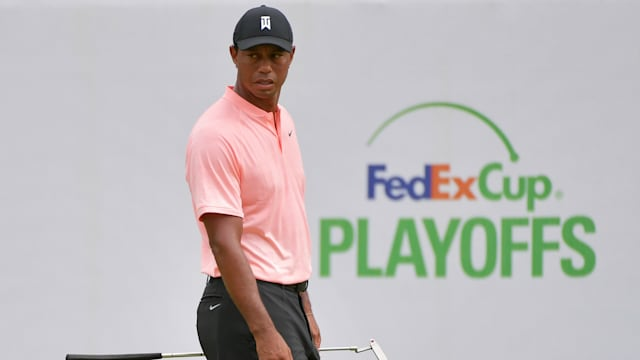 Xander Schauffele holds a two-shot lead at the halfway stage of the BMW Championship as Rory McIlroy and Tiger Woods slipped down the leaderboard.