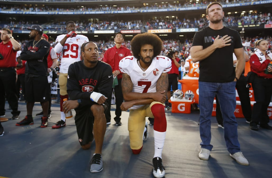 059d27f11 Eric Reid, Colin Kaepernick and Nate Boyer during the playing of the national  anthem on September 1, 2016. (Photo via Getty Images)