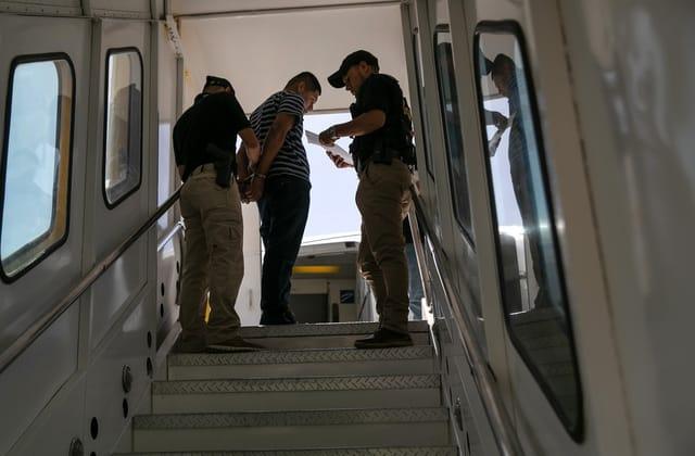 U.S. judge blocks deportation freeze in setback for Biden