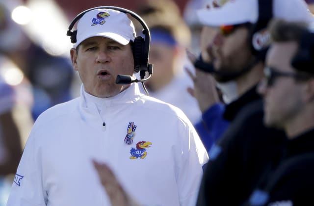 Storied football coach Les Miles placed on leave