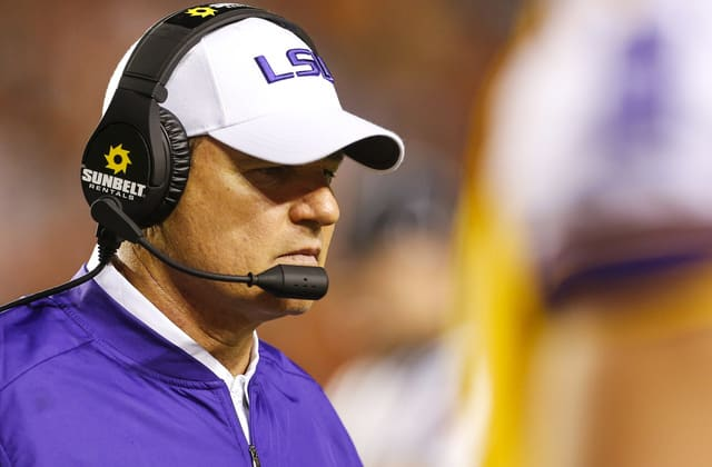 Report: LSU banned football coach from being alone with female students