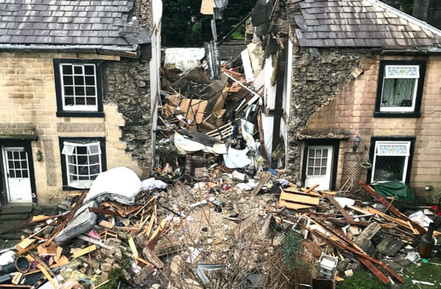 Woman's house exploded 'during call with partner'