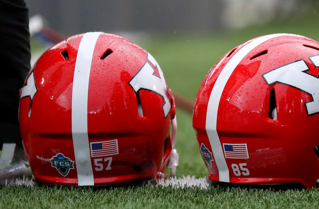 College staffer punished for contact with player