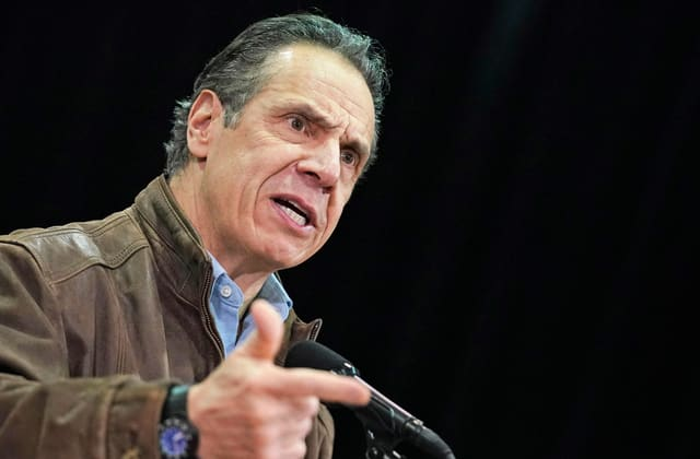 Cuomo calls for review after ex-aide accuses him of sexual harassment