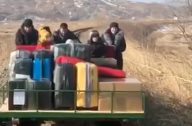 Russians leave N.Korea on hand-pushed rail trolley