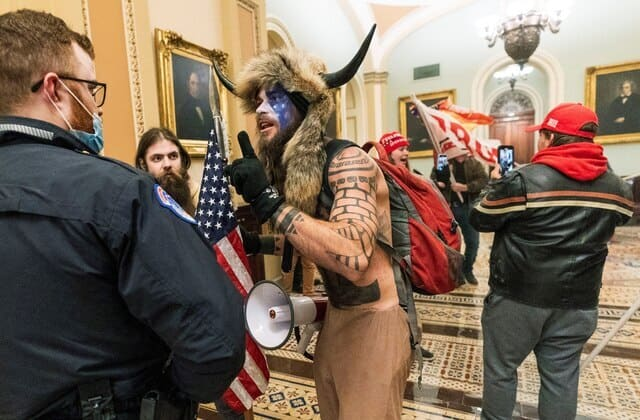 'QAnon Shaman' says he stormed Capitol to 'bring God back into the Senate'