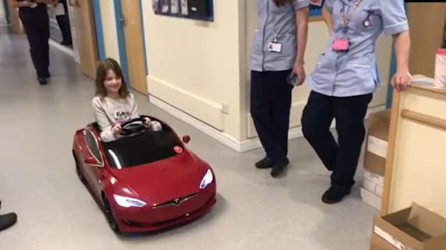 Eight-year-old hospital patient uses miniature Tesla to drive to