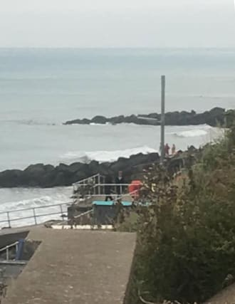 Man in seafront rescue drama 'got plaster cast stuck in rocks' - AOL