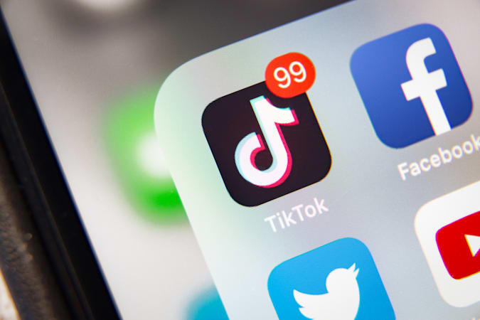 Tyumen, Russia - January 21, 2020: TikTok and Facebook application  on screen Apple iPhone XR