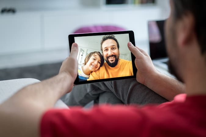 Using tablet for video call with family at home