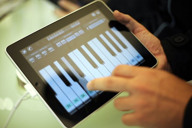 A customer tries out Apple's new iPad with a software featuring a keyboard as it is launched in a shop in Berlin on May 28, 2010. The iPad -- a flat, 10-inch (25-centimetre) black tablet targeted at the leisure market -- was going on sale in Japan, Australia, Britain, Canada, France, Germany, Italy, Spain and Switzerland as part of a staggered global roll-out.     AFP PHOTO    BARBARA SAX (Photo credit should read BARBARA SAX/AFP via Getty Images)