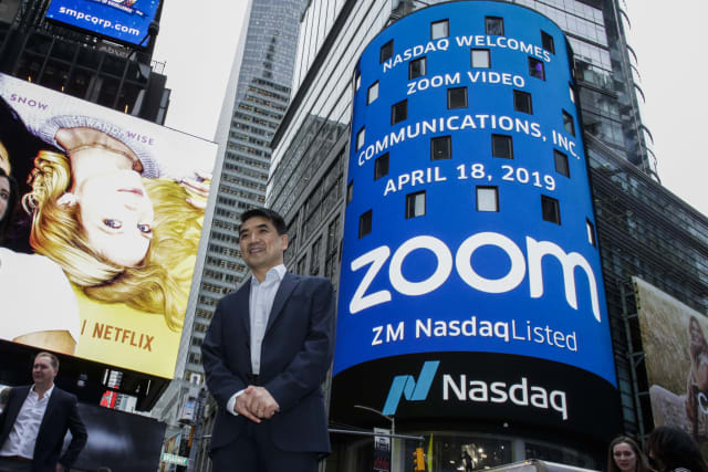 NEW YORK, NY - APRIL 18: Zoom founder Eric Yuan poses in front of the Nasdaq building as the screen shows the logo of the video-conferencing software company Zoom after the opening bell ceremony on April 18, 2019 in New York City. The video-conferencing software company announced it's IPO priced at $36 per share, at an estimated value of $9.2 billion. (Photo by Kena Betancur/Getty Images)