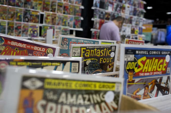 Comic books are displayed at the DC Awesomecon comic book convention in Washington, DC, on May 29, 2015. AFP PHOTO/ ANDREW CABALLERO-REYNOLDS        (Photo credit should read Andrew Caballero-Reynolds/AFP via Getty Images)