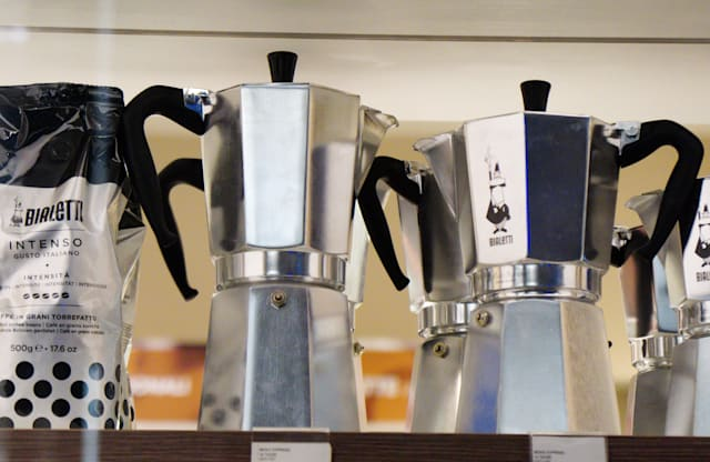 Models of Italy's iconic stove-top Moka coffee maker, Bialetti, are pictured in a store in Rome on October 31, 2018 as the brand has sought protection from creditors while it negotiates an injection of funds to shift to growth products including capsule systems. - The octagonal metal pot that sends steam up through ground coffee became a paragon of Italian design as well as the preferred method for generations of Italians to make their morning expresso. While an updated model remains popular, sales slumped 12 percent in the first half of the year due to shifts in the market and financial difficulties that led to supply problems.  Bialetti racked up a net loss of 15.3 million euros ($17.2 million). (Photo by Vincenzo PINTO / AFP)        (Photo credit should read VINCENZO PINTO/AFP via Getty Images)