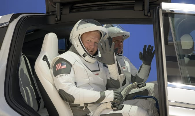 NASA astronauts Douglas Hurley, left, and Robert Behnken, wearing SpaceX spacesuits, depart the Neil A. Armstrong Operations and Checkout Building for Launch Complex 39A during a dress rehearsal prior to the Demo-2 mission launch, Saturday, May 23, 2020, at NASA's Kennedy Space Center in Cape Canaveral, Fla. The SpaceX Falcon 9 rocket, that will send two astronauts to the International Space Station for the first crewed flight from the U.S. in nearly a decade., is scheduled for launch on Wednesday, May 27. (Bill Ingalls/NASA via AP)