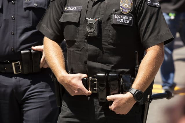 Los Angeles, California / USA - May 1, 2020: A Los Angeles Police (LAPD) Officer wearing a body camera stands watch outside of City Hall.