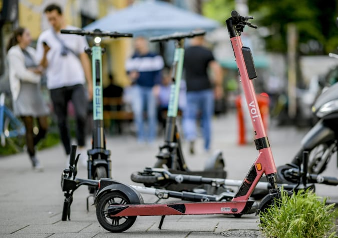 12 June 2020, Hamburg: E-scooters are parked on a sidewalk in Hamburg's Schanzenviertel. The small electric scooters have been on German roads for a year now. Photo: Axel Heimken/dpa (Photo by Axel Heimken/picture alliance via Getty Images)