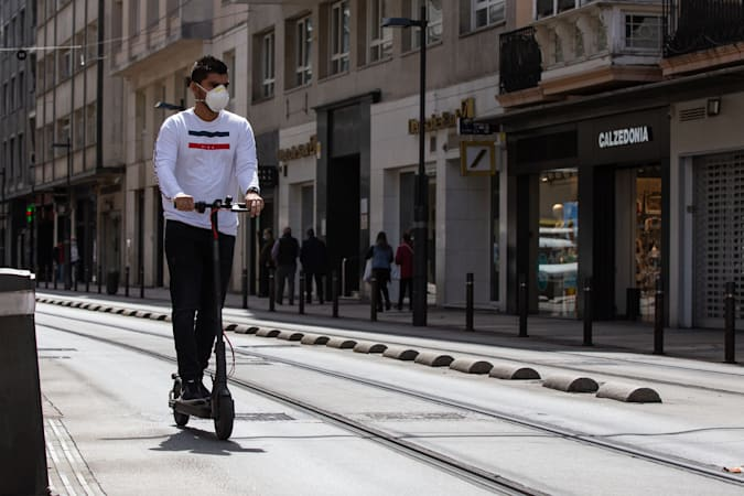 VITORIA, SPAIN - JUNE 12: A man is seen at a electric scooter during the 90th day of the state of alarm, when micro-mobility is becoming a sustainable solution in large cities in the post-COVID era on June 12, 2020 in Vitoria, Spain. Bikes, scooters or electric motorcycles, shared or owned, are a clean and necessary alternative for transport on these days when it is mandatory to maintain a safe distance. (Photo by Iñaki Berasaluce/Europa Press via Getty Images)