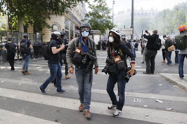 A photo shows AFP photographer Anne-Christine Poujoulat (R) and photographer Jean-Baptiste Autissier during a rally as part of the 'Black Lives Matter' worldwide protests against racism and police brutality, on Place de la Republique in Paris on June 13, 2020. - A wave of global protests in the wake of US George Floyd's fatal arrest magnified attention on the 2016 death in French police custody of Adama Traore, a 24-year-old black man, and renewed controversy over claims of racism and brutality within the force. (Photo by Thomas SAMSON / AFP) (Photo by THOMAS SAMSON/AFP via Getty Images)