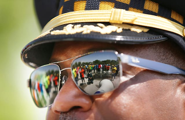Marchers are reflected in the sunglasses of a Chicago police official during a rally in the city's Roseland neighborhood on June 10, 2020. (Stacey Wescott/Chicago Tribune/Tribune News Service via Getty Images)