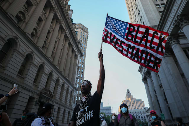 NEW YORK, USA - JUNE 23: A man waves a U.S flag reading 'Black Lives Matter' during an anti-racism protest in New York City, United States on June 23, 2020. The protestors have occupied the City Hall Park in New York City after marching around the City Hall and One Police Plaza. (Photo by Tayfun Coskun/Anadolu Agency via Getty Images)