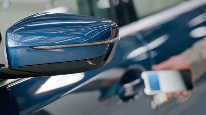 Apple CarKey unlocking a 2021 BMW 5 Series.
