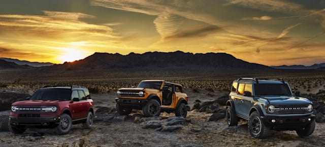 Pre-production versions of the all-new 2021 Bronco family of all-4x4 rugged SUVs, shown here, include Bronco Sport in Rapid Red Metallic Tinted Clearcoat, Bronco two-door in Cyber Orange Metallic Tri-Coat and Bronco four-door in Cactus Gray.