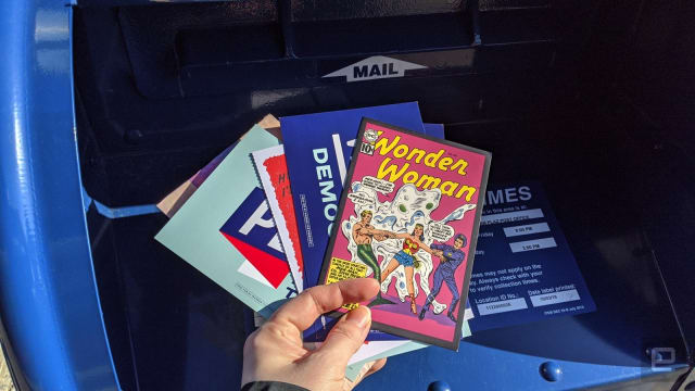 Postcards being put in a mailbox