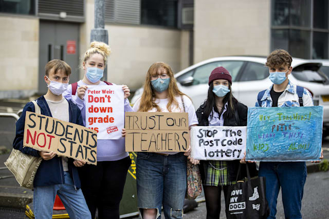 Students with posters during a protest at the Northern Ireland Education Authority main building in Belfast, over Northern Ireland Minister of Education Peter Weir's decision on A level results. (Photo by Liam McBurney/PA Images via Getty Images)
