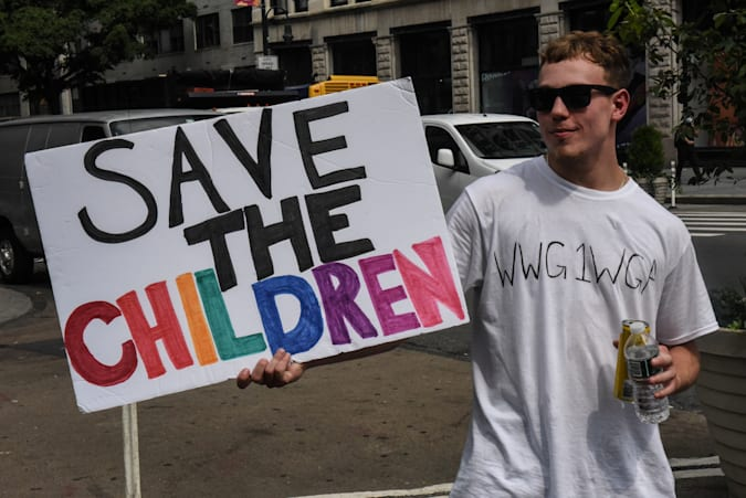 """A person wears a t-shirt with the anagram WWG1WGA, the QAnon slogan, while participating in a """"save the children"""" march and rally in New York City, New York, U.S. August 12, 2020. REUTERS/Stephanie Keith"""