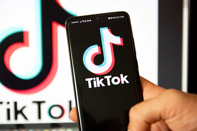 TikTok closeup logo displayed on a phone screen, smartphone and keyboard are seen in this multiple exposure illustration. Tik Tok is a Chinese video-sharing social networking service owned by a Beijing based internet technology company, ByteDance.  It is used to create short dance, lip-sync, comedy and talent videos. ByteDance launched TikTok app for iOS and Android in 2017 and earlier in September 2016 Douyin fror the market in China. TikTok became the most downloaded app in the US in October 2018. President of the USA Donald Trump is threatening and planning to ban the popular video sharing app TikTok from the US because of the security risk. Thessaloniki, Greece - August 1, 2020 (Photo by Nicolas Economou/NurPhoto via Getty Images)