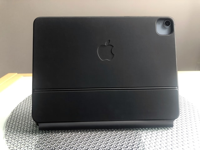 A rear view of the 2020 Apple iPad Air with the Magic Keyboard accessory attached.