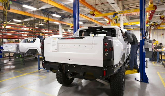 Two GMC HUMMER EVs completing their builds prior to shipping for continued validation testing. (Photo by Jeffrey Sauger for General Motors)