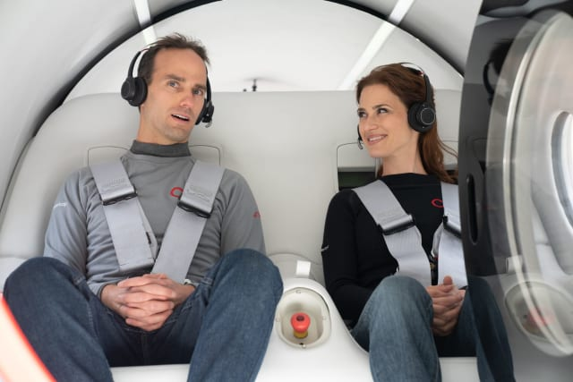 Josh Giegel and Sara Luchian travel in the first crewed Hyperloop pod test