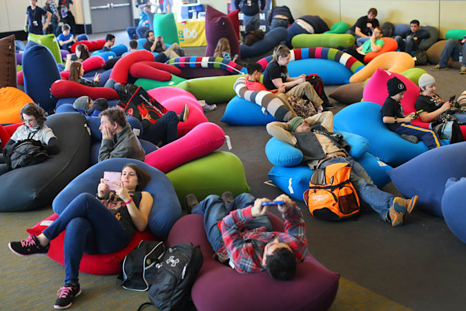 BOSTON - MARCH 6: The huge PAX East gaming convention was held at the Boston Convention and Exhibition Center.  Tired conventioneers relax on cushions on the floor.  (Photo by John Tlumacki / The Boston Globe via Getty Images)