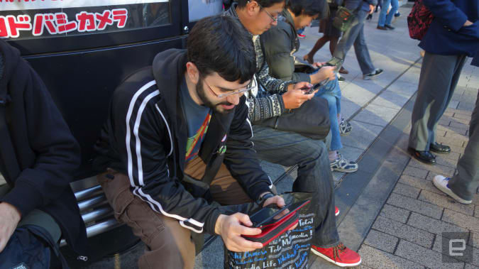 Ian Levenstein doing StreetPass in front of the Yodobashi camera in Akihabara in Tokyo